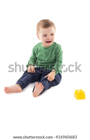 Portrait of a crying little boy isolated on white background - stock photo