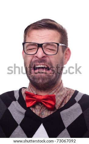 Portrait of a crying nerd. Isolated on white. - stock photo