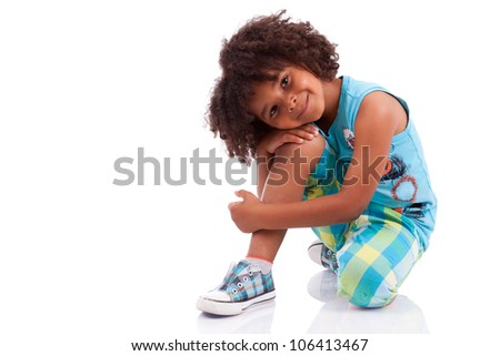 Portrait of a cute african american little boy, isolated on white background - stock photo