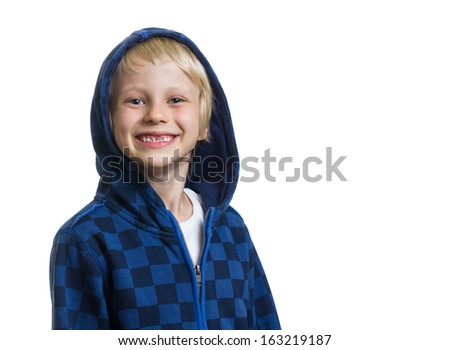 Portrait of a cute and happy young boy with missing front teeth in a blue hoodie isolated on white with copy-space - stock photo