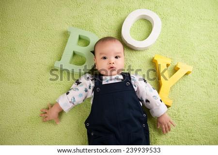 "Portrait of a cute baby boy. ""BOY"" letter. - stock photo"