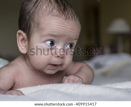 Portrait of a cute baby crawling in bed - stock photo