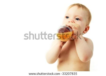 portrait of a cute baby drinking juice - stock photo