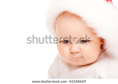 Portrait of a cute baby in a large Santa hat - stock photo
