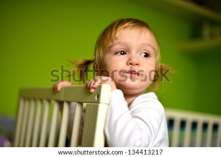 Portrait Of A Cute Baby, Indoors - stock photo
