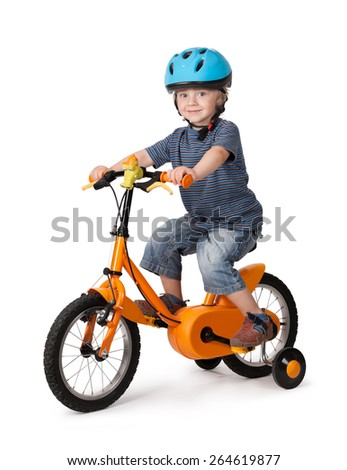 Portrait of a cute boy on bicycle on a white - stock photo