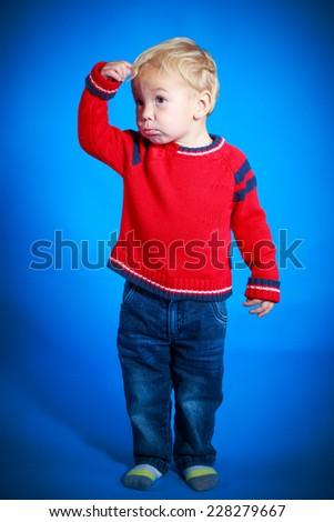 Portrait of a cute boy on the blue background - stock photo