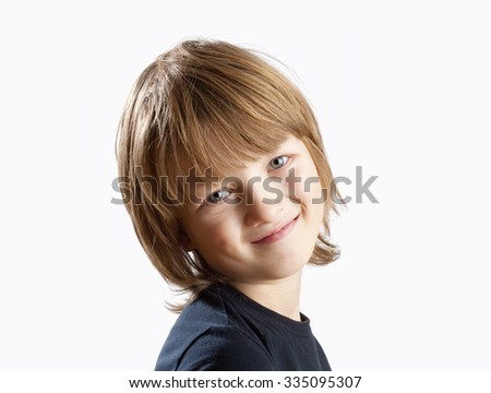 Portrait of a Cute Boy with Blond Hair Smiling  - stock photo