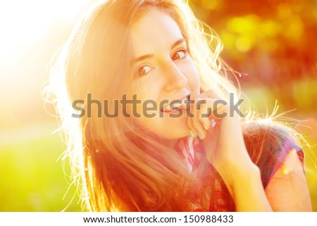 portrait of a cute cheerful girl in the sunshine - stock photo