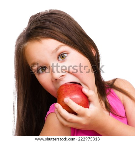 Portrait of a cute cheerful little girl with red apple, isolated over white - stock photo
