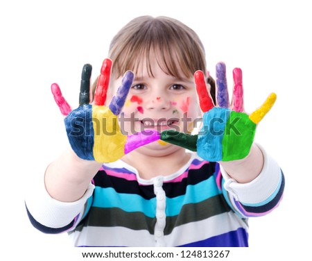 Portrait of a cute child girl with painted hands - stock photo