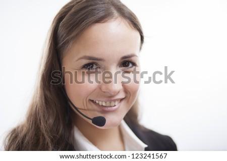 Portrait of a cute contact center representative - stock photo