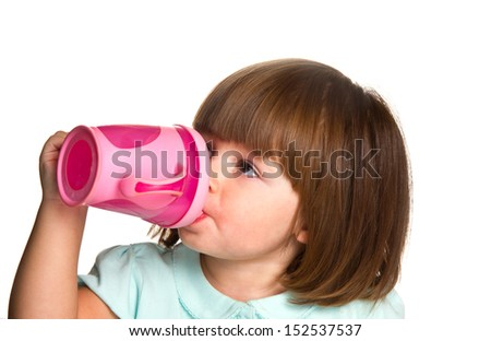 Portrait of a cute drinking little toddler girl  - stock photo