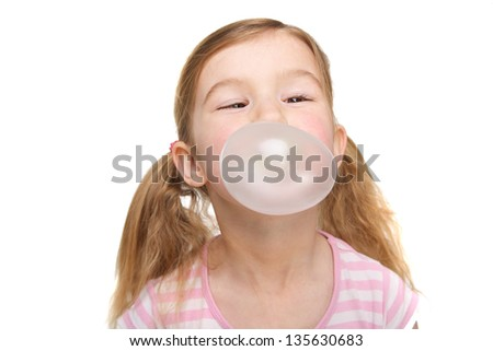 Portrait of a cute girl blowing bubbles - stock photo