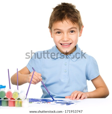 Portrait of a cute happy boy playing with paints, isolated over white - stock photo