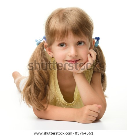 Portrait of a cute happy little girl laying on floor, isolated over white - stock photo