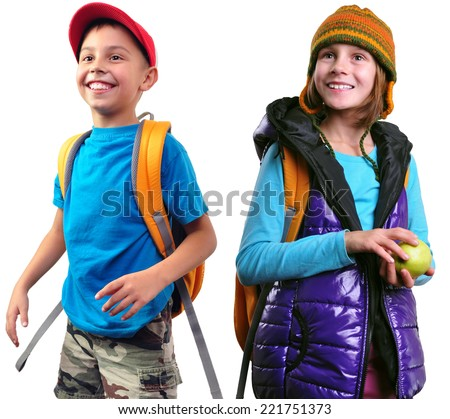 Portrait of a cute happy smiling little schoolgirl and schoolboy with yellow backpack, apple and a hat looking up. Isolated over white background. Happiness childhood travel concept - stock photo