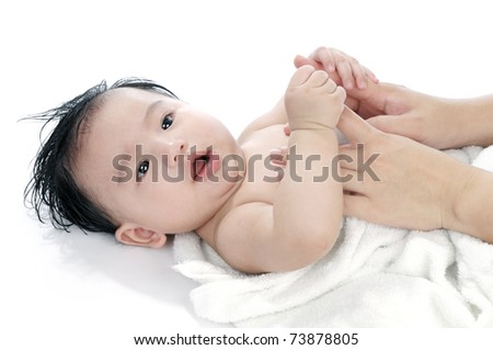 Portrait of a cute infant baby lying on back, over white background. - stock photo