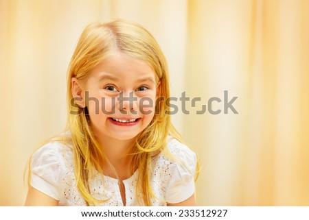 Portrait of a cute joyful girl at home. - stock photo