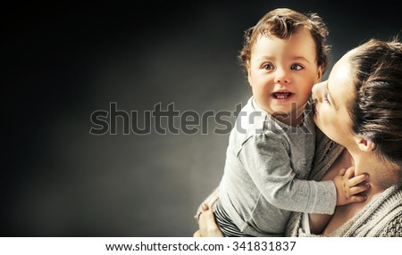 Portrait of a cute little baby with mother - stock photo