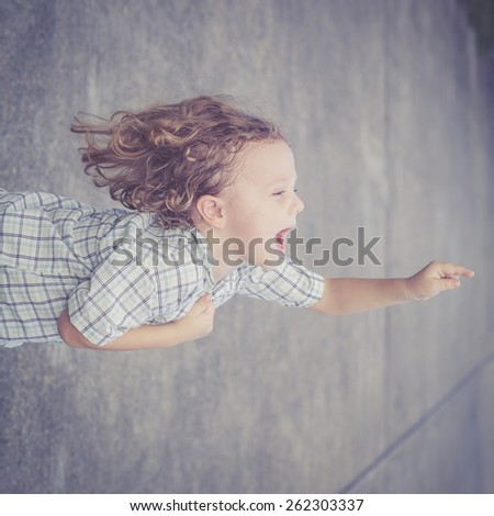 Portrait of a cute little boy at the day time - stock photo