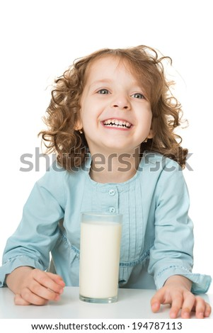 Portrait of a cute little girl drinking milk, isolated over white - stock photo