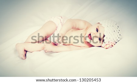 Portrait of a cute little girl in a cap on a white background - stock photo