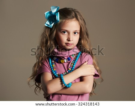 Portrait of a cute little girl in a dress. beautiful child - stock photo