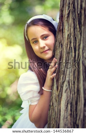 Portrait of a Cute Little Girl in her First Communion Day - stock photo