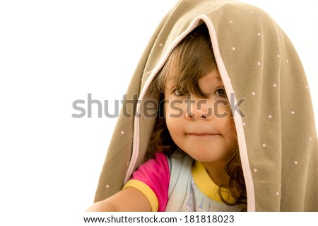 Portrait of a cute little girl with towel on her head - stock photo