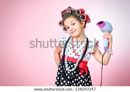 Portrait of a cute little pin-up girl over pink background. - stock photo