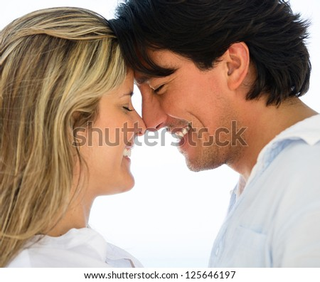 Portrait of a cute loving couple looking happy - stock photo