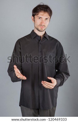 Portrait of a cute man in shirt - stock photo