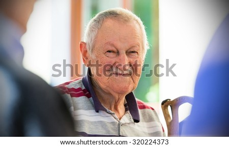portrait of a cute old man - stock photo