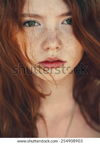 portrait of a cute red-haired girl close-up - stock photo