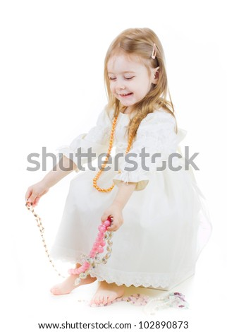 portrait of a cute smiling girl sitting on a box with jewelry - stock photo