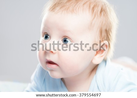 Portrait of a cute smiling infant baby. Happy childhood concept.  - stock photo