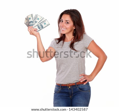 Portrait of a cute smiling lady holding dollars while standing on white background - stock photo