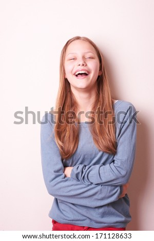 Portrait of a cute smiling teen girl - stock photo