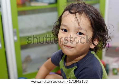 portrait of a cute smiling young boy - stock photo
