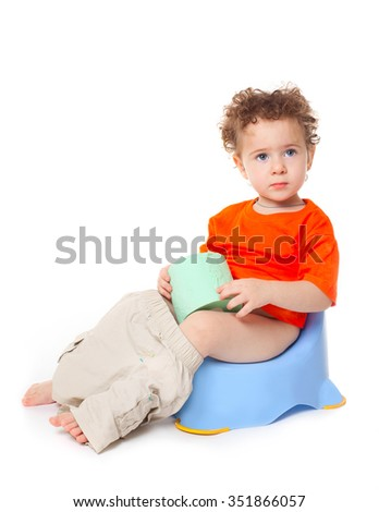 Portrait of a cute surprised little  baby boy kid child  girl on potty with lavatory paper, isolated on white background - stock photo