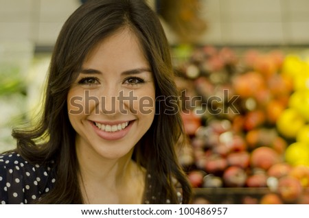 Portrait of a cute woman in the supermarket - stock photo