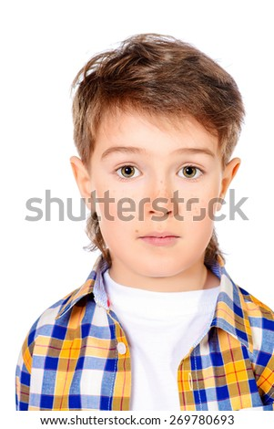 Portrait of a cute 7 year old boy. Copy space. Isolated over white. - stock photo