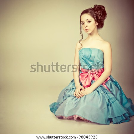 Portrait of a cute young  girl dressed as a princess - stock photo