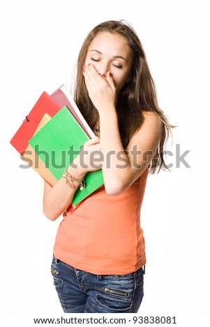 Portrait of a cute young student girl bored, yawning. - stock photo