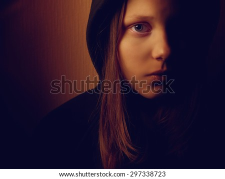 Portrait of a depressed teen girl. Pain and fear. - stock photo