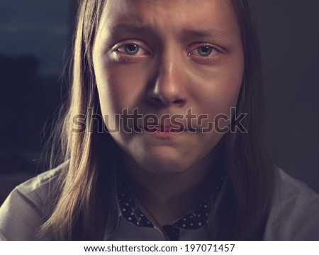 Portrait of a depressed teen girl, studio shot - stock photo