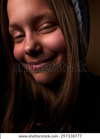 Portrait of a devil teen girl with a sinister smile, closeup - stock photo