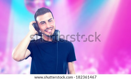 Portrait of a Dj in a disco - stock photo