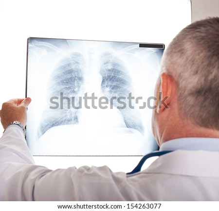 Portrait of a doctor looking at a radiography - stock photo